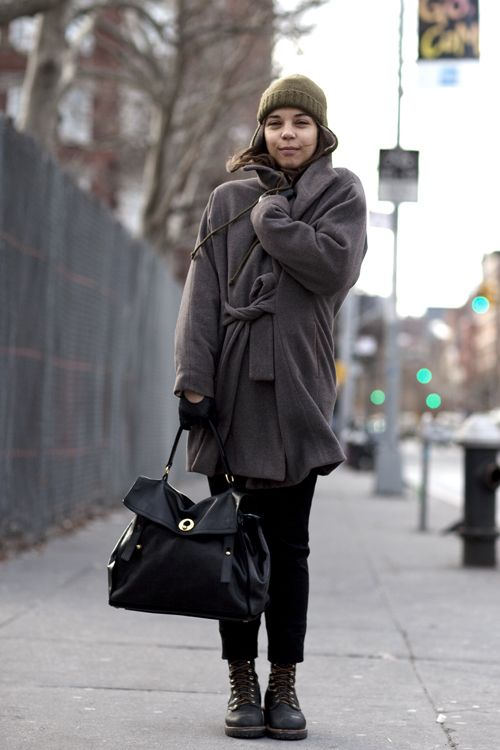 What a weird mixture of styles... lady bag, masculine boots, feminine jacket...