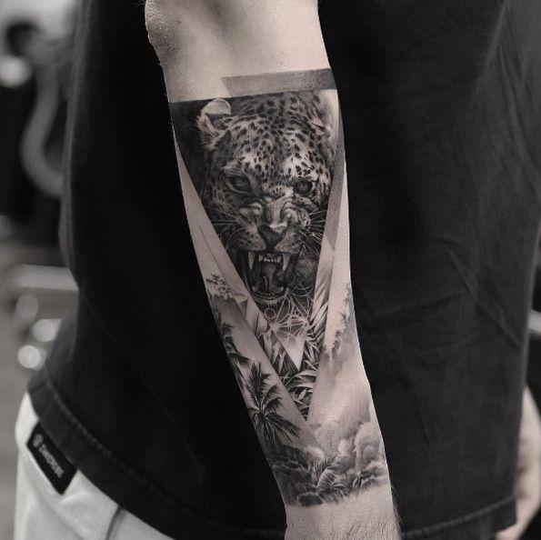 Jungle cat forearm tat by Oscar Akermo