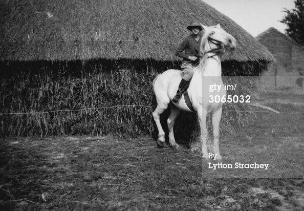 Dora Carrington, on her horse 'Belle' near Ham Spray in Wiltshire.
