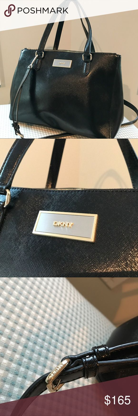 DKNY Leather Tote‼️ Brand new bag! No flaws scratches or use on this awesome tote.. this bag is a shiney leather with gold accents and has two zipper parts and a button middle with a long strap can be worn as a cross body DKNY Bags