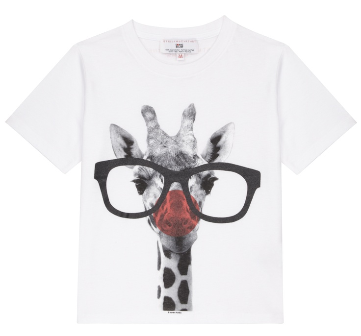 A white short-sleeved T-shirt featuring an image of a giraffe, with the addition of a red nose and glasses. Designed by Stella McCartney exclusively for Red Nose Day. With at least £2.50 going to Comic Relief, helping to change lives across the UK and Africa, t-shirt is £5.99. £2.50 would buy a white cane for someone in Africa who is blind, giving them more independence. 100% organic Fairtrade certified cotton. Wash at 40.