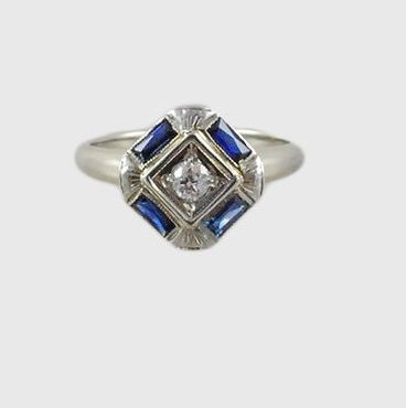 This antique deco and sapphire ring.   65 Impossibly Beautiful Alternative Engagement Rings You'll Want To Say Yes To