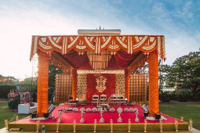 South Indian mandap, mandapam designs, marigold flowers, orange and gold mandap, genda flower, outdoor mandap, mandap backdrop motif, floral wall