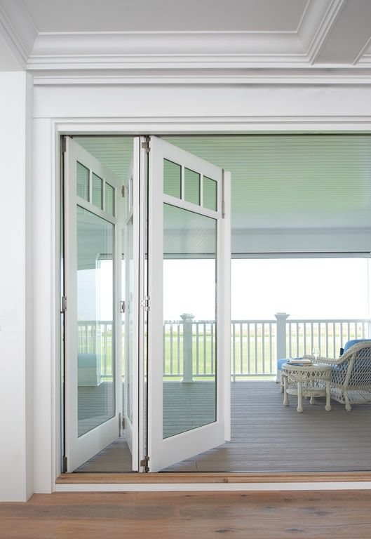 Contemporary porch with marvin bi fold door wrap around for Front door with opening window