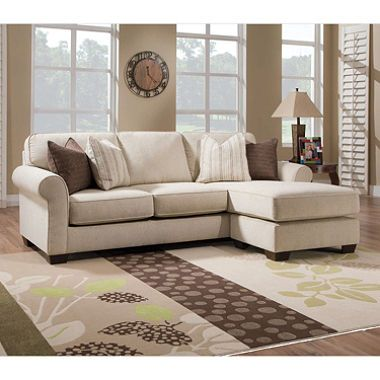 cream sofa with independent ottoman to switch chaise from side to side