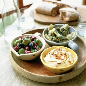Mezze platter:Lemon and garlic artichokes, with garlic, olive oil and thyme leaves, houmous with pinenuts, paprika, and marinated olives with a shallot, and parsley, bread