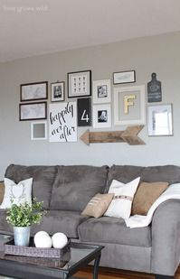 Collage behind the couch.