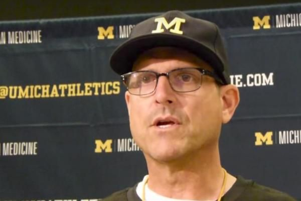 Michigan coach Jim Harbaugh kept it close to the khakis when it came to revealing the team's roster.