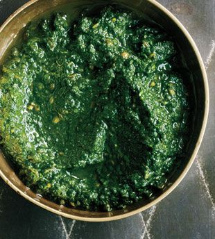 Green Harissa by boappetit: Made with cilantro, spinach garlic chile coriander, cumin and olive oil, this is great with chicken, fish, or lamb or on pitas! #Harissa #Condiments #bonappetit
