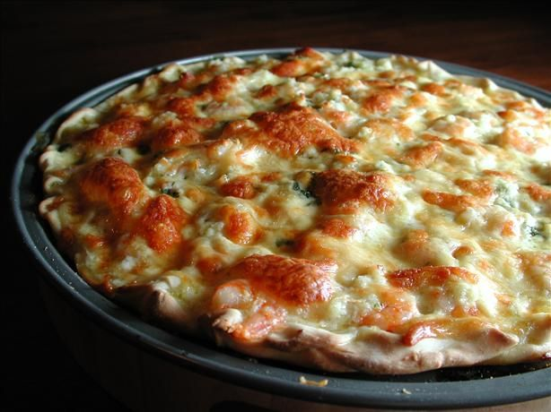 Seafood Pizza from Food.com: This was created to mimic the wonderful seafood pizza we used to enjoy at Pizzeria Uno in Cincinnati Ohio. It's especially easy with a boboli crust but making your own crust may taste better. I recommend using the fake crab rather than canned, but fresh crab would be best. It's rich and delicious. I love to dip it in cocktail sauce. YUMMY!!