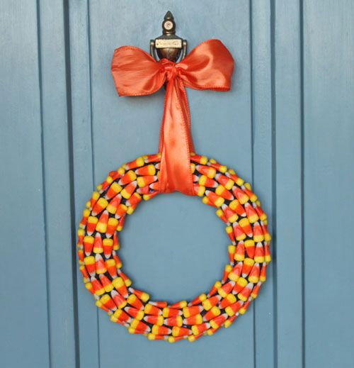 Candy Corn Wreath  Sweeten up your front door with this welcoming candy corn wreath!  Learn more at Oh Nuts