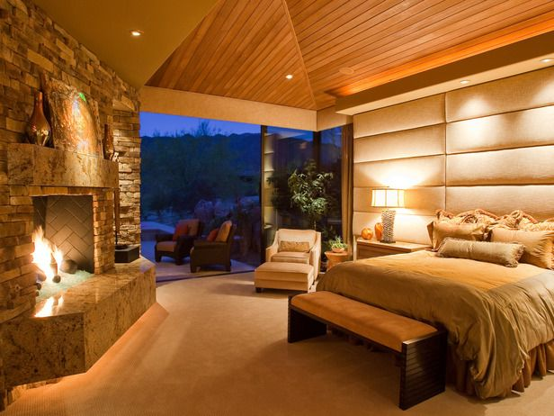 Giant headboard and a huge fireplace. Awesome bedroom with private patio.