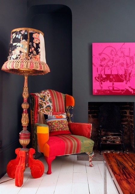 Love the dynamic contrast of the deep graphite grey walls and the hot flirty colors in the lamp and chair