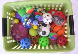 This purpose of this first problem is to get the kids thinking and talking about attributes. To do this, I have collected a big basket of balls--yes, balls! I have all different colors and sizes--big balls, little balls, glittery balls, bouncy balls, squishy balls..