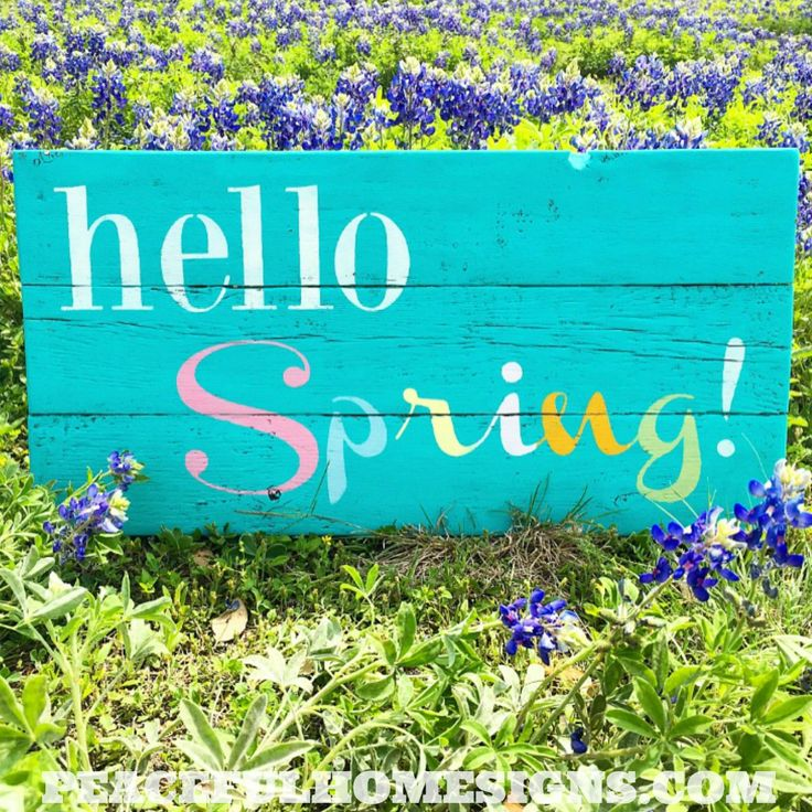 """Hello Spring!"" This reclaimed wood sign is 10.5x22 and comes with an attached hanger. We love marrying the rustic look of reclaimed wood with the trendy and cozy farmhouse style. #spring #springdecor #easter #springhassprung #homedecor #farmhouse #reclaimedwood"