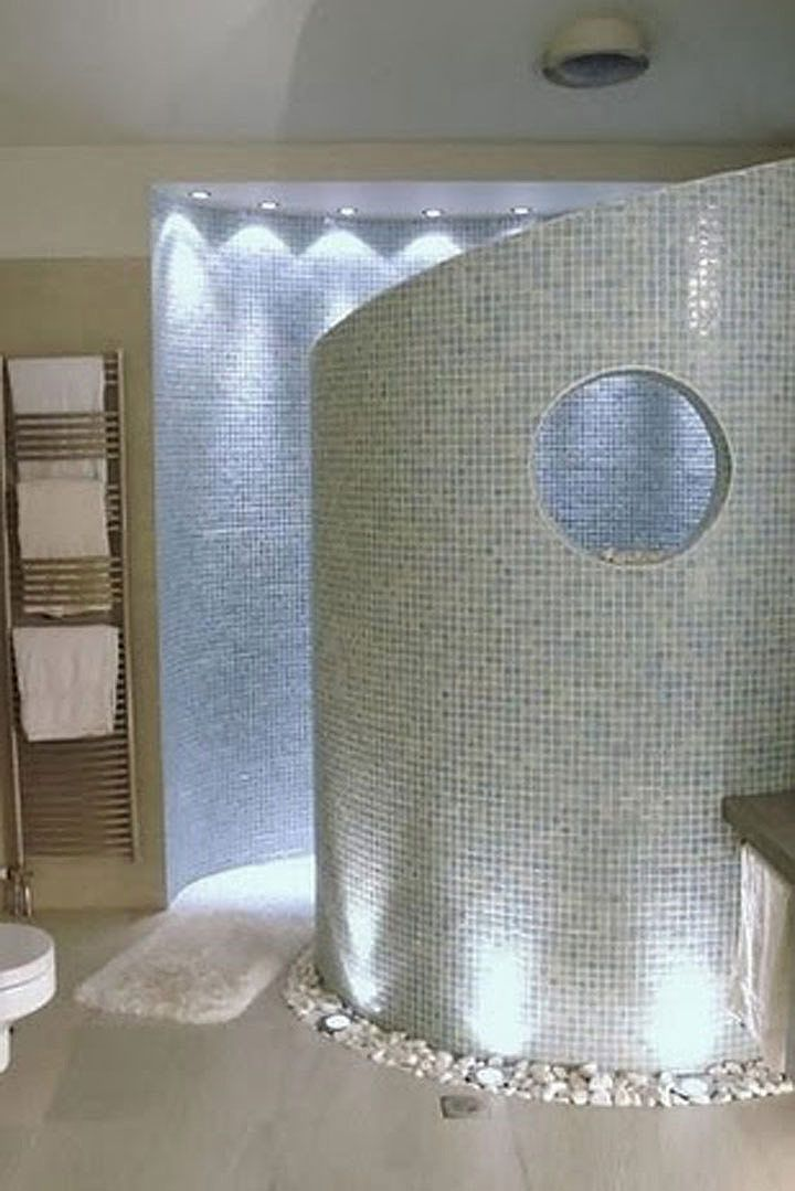 Superb Curved, Walk In Shower: No Doors Or Glass To Clean! Love The Round Window,  The White Stone Edging, The Wall Lighting! Is That White Gravel Or Polished  Tile ...