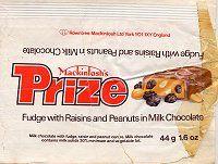 Mackintosh's Prize Bar Chocolate wrapper. A milk chocolate covered fudge bar with raisins and peanuts