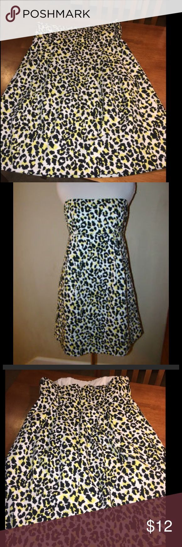 Michael Kors Size 10 Strapless Cheetah Print Dress Michael Kors dress.  Strapless, fit and flare style.  Cheetah print.  Mid thigh length.  Size 10.  Excellent condition.  Important:   All items are freshly laundered as applicable prior to shipping (new items and shoes excluded).  Not all my items are from pet/smoke free homes.  Price is reduced to reflect this!   Thank you for looking! Michael Kors Dresses Mini