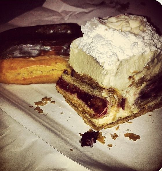 Thing Sally had in Europe. Flaky pastry jam rolls embedded in light fluffy custard (pastry cream mixed with whipped cream?) and whipped cream on top.
