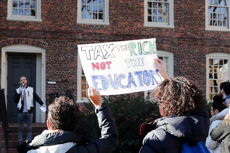 Brown protest: Tax the rich, not the educators. In solidarity with graduate students across the country organizing similar demonstrations, close to 100 graduate students gathered outside University Hall.