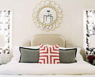 Absolutely love this space! gray &red modern bedroom design with tan leather headboard with gorgeous silver gold toned sunburst mirror and beautiful gray red throw pillows! Love the damask black & white fabric roman shades! tan beige paint wall colors! Gray black red white silver gold bedroom space color