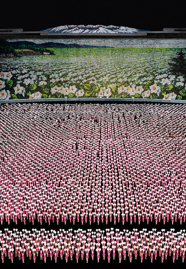 German visual artist Andreas Gursky is often recognized for his enormous architecture and landscape color photographs, often using an aerial vantage point, frequently identifying systematized aspects of culture.