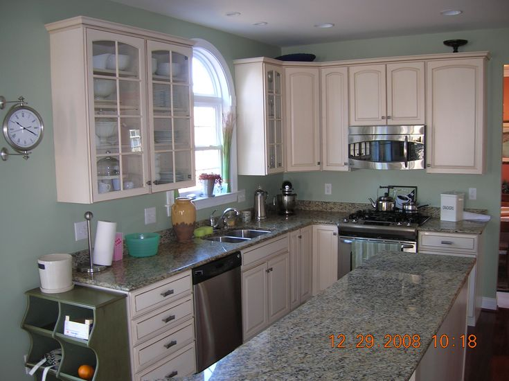 Sherwin williams softened green great color for kitchen for Grey green paint color kitchen
