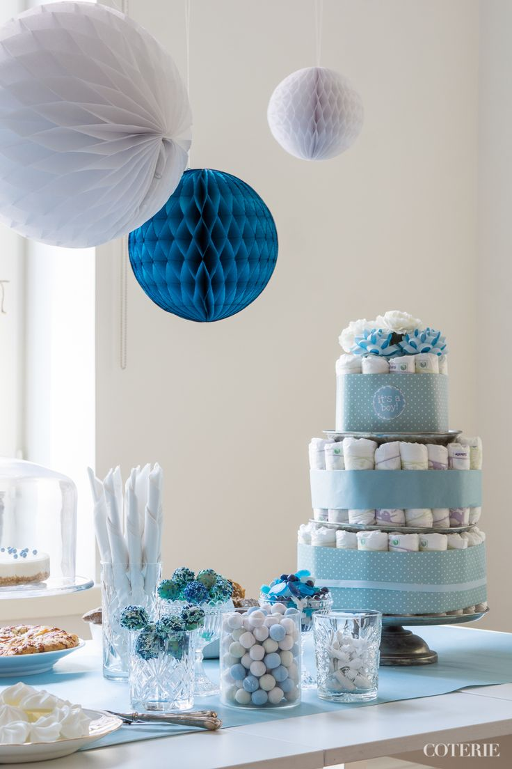 It's a boy! Decoration ideas for a baby shower.  A classic diaper cake was the centerpiece of the table. <3 And honeycomb paper balls gave the final touch for the decoration!   Check out the whole blog post here: http://www.coterie.fi/baby-shower-for-a-boy-vauvakutsut-pojalle/