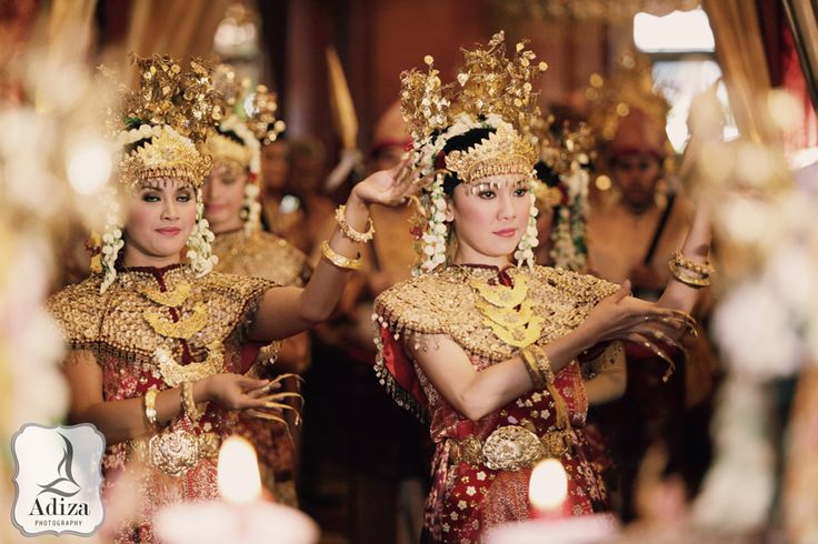 """""""Kirab Pengantin"""" the bride walking to the wedding accompanied by some of traditional dancer."""
