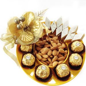 Rakhi Ferrero Mithai Platter Milton microwave safe platter comes with 200 grams kaju katli, 200 grams of almonds and 16 pieces of Ferrero Rochers chocolates. Rs 2700/- http://www.tajonline.com/rakhi-gifts/product/r4569/rakhi-ferrero-mithai-platter/?aff=pint2014/