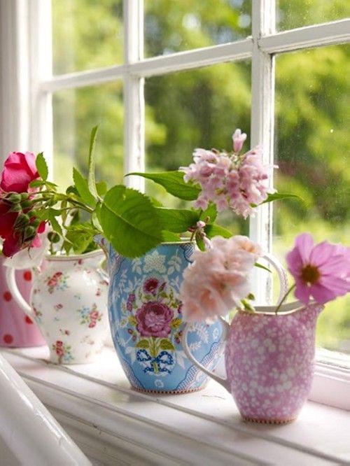 window flowers in pastle vases