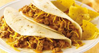 Cheesy Fiesta Tacos: Tacos made with McCormick® Cheesy Taco Seasoning Mix are a family favorite for a busy weeknight dinner.