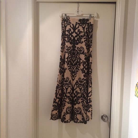 Super Cute Maxi Skirt with Chandelier Print Dark Tan Maxi Skirt with Black Chandelier Print Size: Small ~ NEVER BEEN WORN ~ I bought it from a good friend who had a boutique in Los Gatos, CA and just bought it to support her endeavor NO TRADESPlease make all offers through offer tool ~ offers made in comment section will not be considered or addressed Thank You ✨ Skirts Maxi