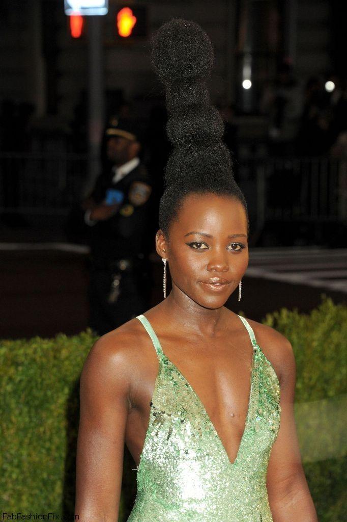 Lupita Nyong'o shined in Calvin Klein Collection gown while walking the red carpet at the 2016 Met Gala. #glamorous #metgala #metball