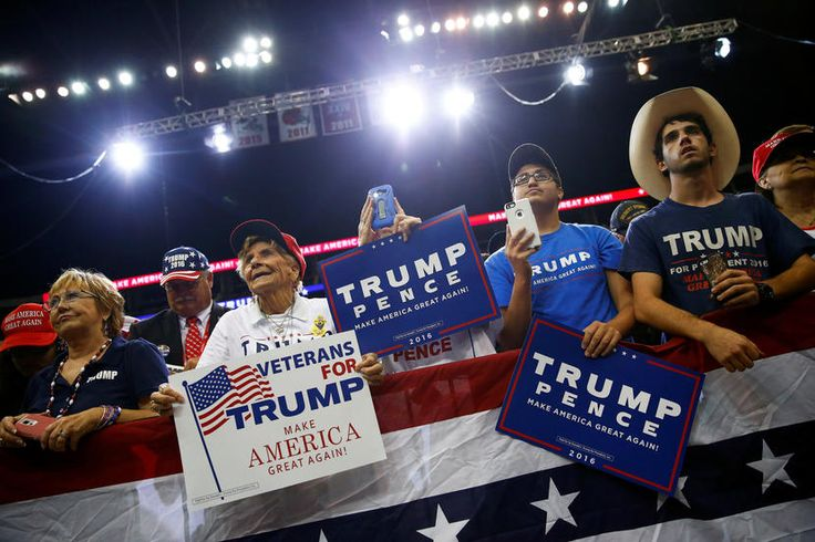 Supporters watch as Republican presidential nominee Donald Trump attends a campaign event at the Jacksonville Veterans Memorial Arena,  Aug. 3, 2016,  in Jacksonville, Fla. (Photo by Eric Thayer/Reuters)