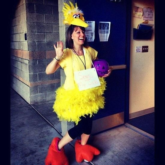 A Big Bird Costume With Red Feet