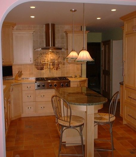 Red Flooring Kitchen: Red Floor, Maple Cabinets, Neutral Countertop And Wall