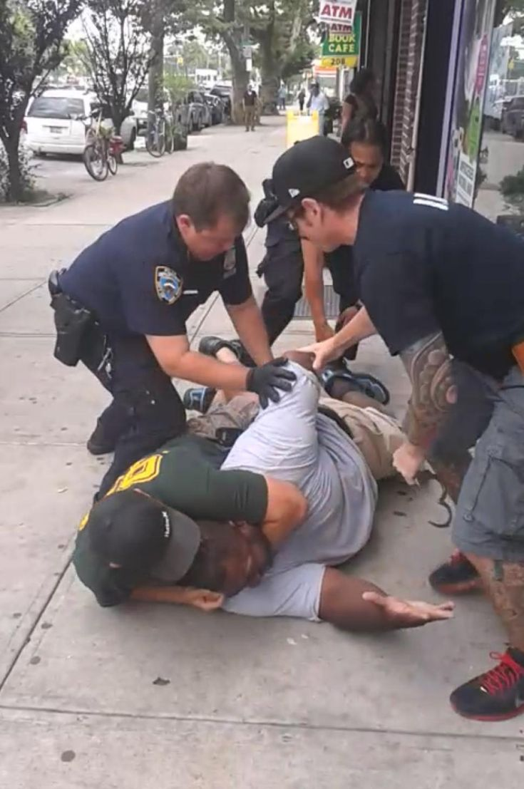'I can't breathe! I can't breathe!' Eric Garner repeatedly screamed after at least five NYPD officers took him down in front of a Tompkinsvi...