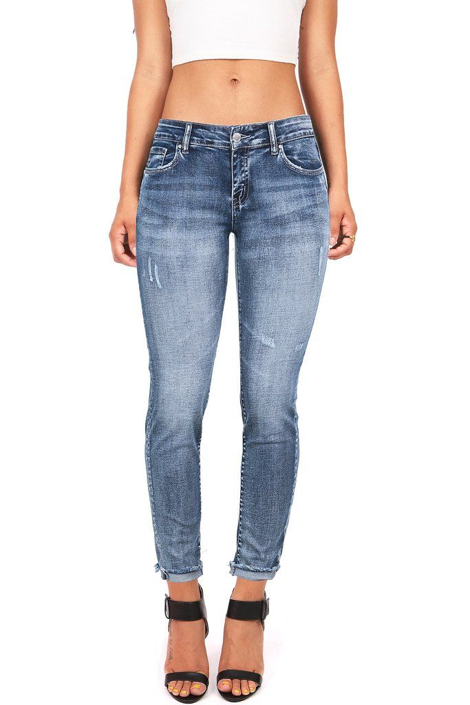 """Low rise ankle skinny jeans in a faded denim wash with a frayed hem. Traditional 5 pockets with button and zip fly closure. Worn in/faded denim looks great dressed up in dressy blouse with strappy heeled sandals. Little stretch in denim. *Machine Wash Cold*95% Cotton/4% Polyester/2%Rayon/1% Spandex*36/91 cm Top to Bottom 26.5""""/67 cm Inseam (Measured from Size 5) Model is 5'5 and Wearing a Size 3.*Refer to Bottoms Size Chart #2*Imported"""