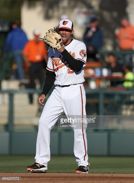 News Photo : J.J. Hardy of the Baltimore Orioles shouts of the...