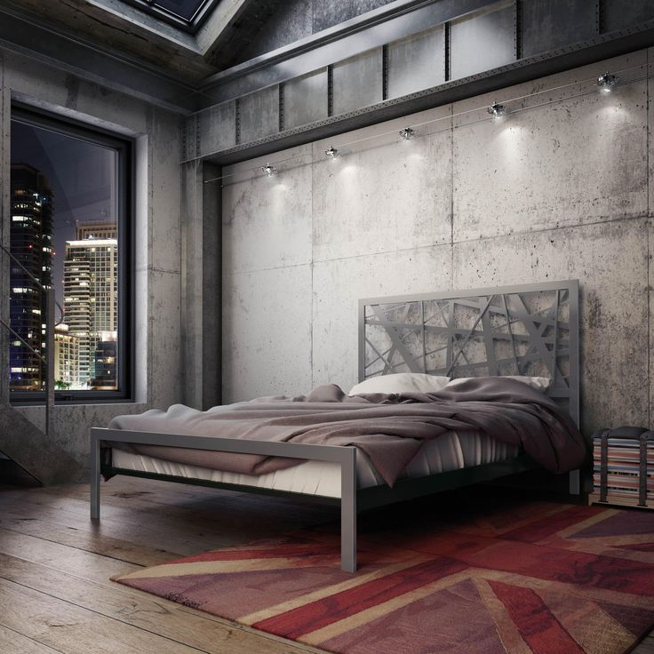 A Bed Dressed To The Nines, Topped Off With A Structured Metal Headboard  That Echoes