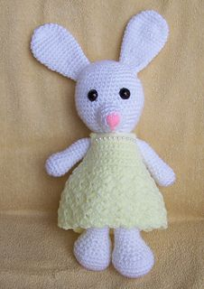 I designed my own dress and its a free pattern on Raverly now Beaded Bunny Dress.  I love this bunny that Sharon designed & am having so much fun making the cloths.  I have 2 young grand-daugh...