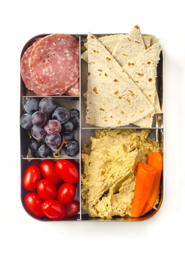 Bento Lunchbox  Hummus and Pita Plate  Nine out of 10 kids love a good smear of hummus. Why not make it the star of the show?      Get a recipe: How To Make Hummus from Scratch     Pack with: Salami, olives, carrots, baby tomatoes, and grapes. (Note that dipping is easier and less messy if you pack the hummus in a separate container.)