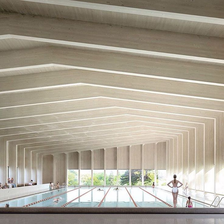 A cross-laminated timber roof covers this six-lane swimming pool, which London firm Hawkins\Brown plans to add to a school in Surrey. Read the full story on dezeen.com/tag/swimming-pools #architecture #swimmingpools