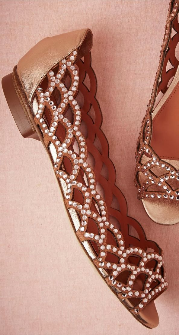 Brown flats with embroidered detail