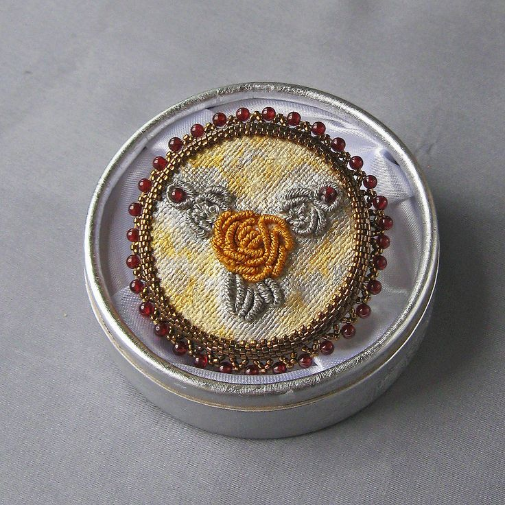 https://flic.kr/p/21v3hXQ | GARNET ROSE SILK BROOCH. | Beautiful brooch made of natural garnet. The cabochon made by hand embroidery with silver and bronze silk, also the background is painted with metalic colors (silver, antique gold and pearl ivory) for textile. The back of cabochon is lined with natural cream - colored leather. The brooch is embedded with Miyuki Delica beads and natural garnet spheres. On the back is attached a needle with protection made of stainlees steel.