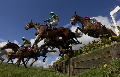 Some Target and Declan Lavery get a big jump off the drop fence during the La Touche Cup Punchestown Festival
