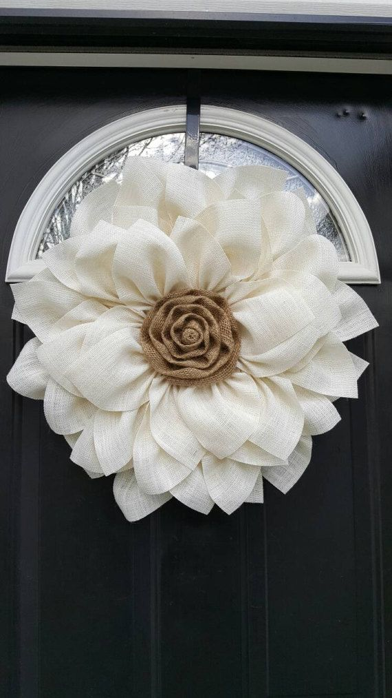 This White Burlap flower is a perfect addition to any home decor. It can be used as a wreath or as wall decor. The frame is not included. It for inspiration only. This wreath measures 17 to 18 inches. Edges are treated so NO FRAYING!!! ****Other colors available! Please feel free to message me with any questions! ***This wreath should not get wet. Bring in during storms.