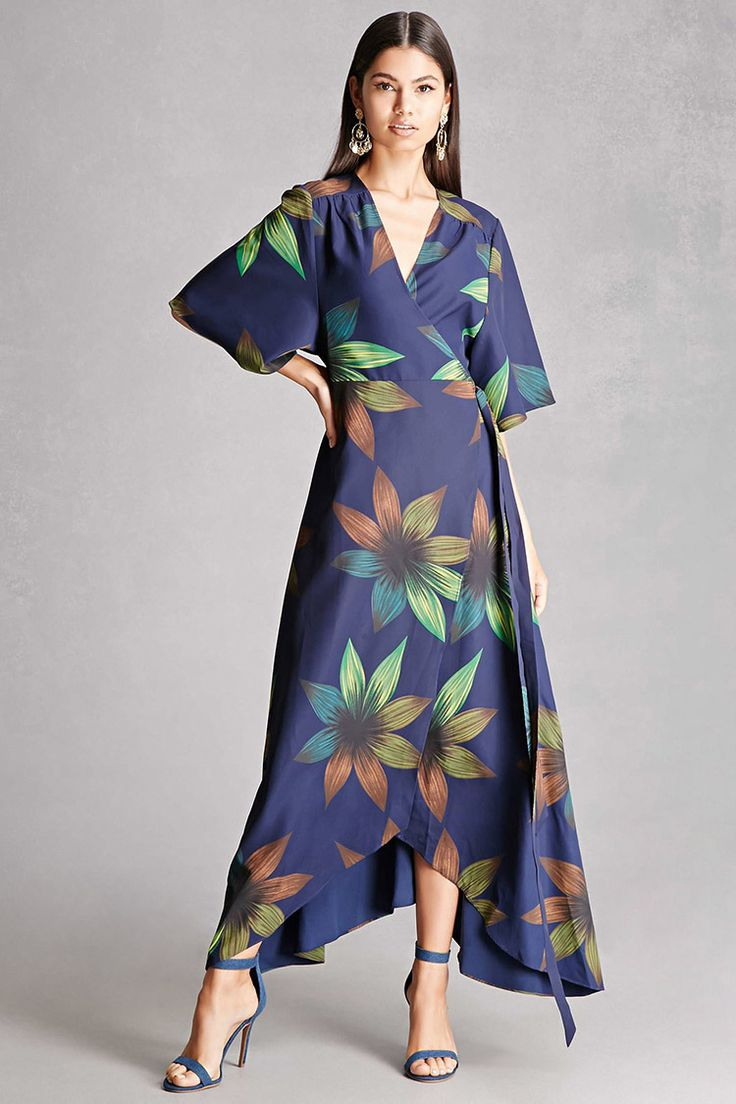 A midweight woven wrap dress by Nightwalker™ featuring a floral pattern, surplice neckline, self-tie waist, short sleeves, and a flared hem.