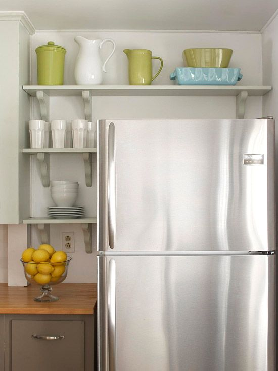 Small but Stylish Kitchen Savvy Storage Ideas Any extra storage space provides a big impact in a small kitchen. Moving the refrigerator just 13 inches to the right provided enough room to add another base cabinet and more countertop space. Open shelving installed around the refrigerator implemented even more storage, keeping everyday dishware within easy reach.